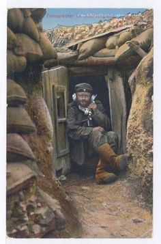 WW1, German postcard. Communication between the trenches:  German soldier uses a…