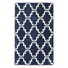 Anchor your living room or define areas in the den with this hand-tufted wool rug, featuring a Moroccan trellis-inspired motif in navy.   ...