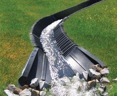 SmartDitch is a maintenance free and ideal solution for slope stabilization, drainage, and erosion / sediment control. Backyard Drainage, Landscape Drainage, Drainage Ditch, Backyard Landscaping, Landscaping Ideas, Drainage Pipe, Steep Hillside Landscaping, Backyard Stream, Rain Garden