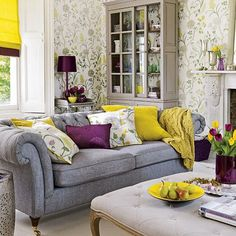 Mixing saturated purples and yellows and greys. Patterned wallpaper and cushions