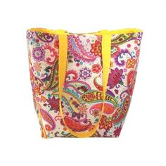 Paisley Tote Bag, Floral Cloth Purse has Colorful Paisley  Flowers on a White Background.   Paisley  Flowers are Pink, Purple, Yellow, Orange, Blue  Green.   This Handmade Handbag is fully lined in Yellow, has 5 slip type Orange pockets, 2 Yellow handles  a Magnetic Snap Closure.   I use thick fleece interfacing, sandwiched between the lining  outer fabrics to add stability  durability to this fabric tote bag.   This is the perfect size for an everyday purse, book bag, tote bag, craft bag…