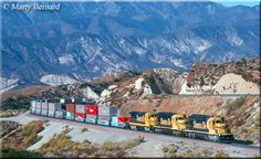 Santa Fe and run elephant-style (nose-to-tail) along the pass at milepost 57 as they power an intermodal freight on October Bnsf Railway, Burlington Northern, October 19, Train Travel, Train Station, Cityscapes, Boxers, Locomotive, Santa Fe