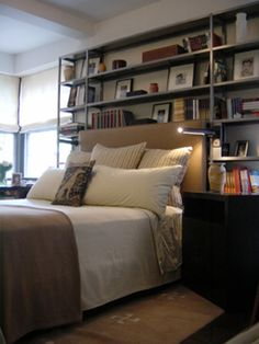 bookshelves behind the bed