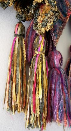 Boho Gypsy Glam ~ Tassels with a gypsy feel.Great way to use up those scraps of eyelash yarn, and ribbons. Gypsy Style, Boho Gypsy, Diy Tassel, Tassels, Textiles, Do It Yourself Inspiration, Passementerie, Creation Couture, Textile Art