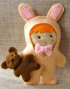 #felt #doll in bunny rabbit costume  what a cute idea! do lots of cute costumes! even re-create each year's halloween costumes?  :)