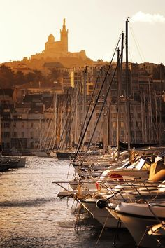 Sunset on the Old Port of Marseille, with a view on the iconic church Notre-Dame-de-La-Garde, built at the highest natural point in Marseille. #France #Provence #Travel