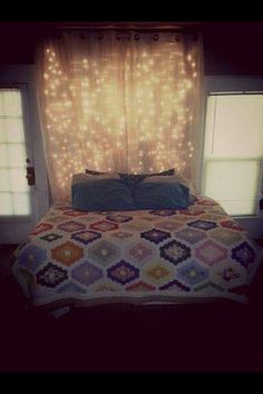 Cool idea. Curtain with fairy lights behind