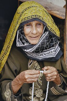 Yemen. This woman is lovely. Look how she still takes care of herself screening her face from the sun and painting her nails.