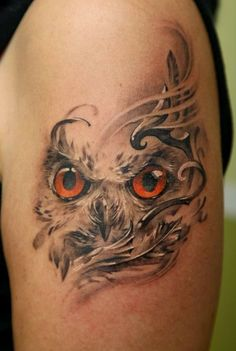 owl tattoo - red eyes -