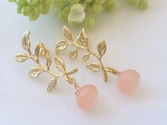 This is an delicate pair of earrings made from pink chalcedony onion drops hang on gold plated leafy posts. So romantic and feminine!