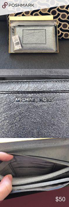 Michael Kors Wristlet Brand new still in box with wrapping. Silver Michael Kors wristlet. Michael Kors Bags Clutches & Wristlets