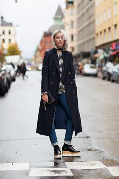 Ankle-Length Coats, Winter's #1 Trend - long black winter coat worn with a stripe shirt + cuffed skinny jeans and platform shoes