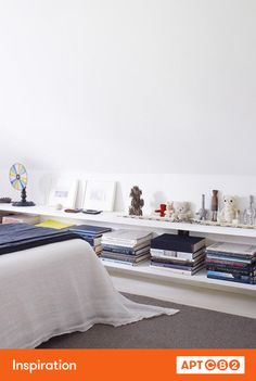 I swoon for the clean shelving that acts as a proper surface to display thoughtfully curated coffee table books and the various collected objects that tell your story. #APTCB2 #workswithCB2