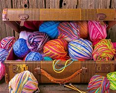 Get tangled up in Case of Colors, our 1000 piece jigsaw puzzle. This gorgeous photo shows a suitcase overflowing with colorful balls of yarn.  #colorful #jigsawpuzzle #springbok #knitting #yarn