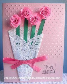 Round doily and tissue flowers would make a pretty Mother's Day card