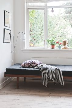 Scandinavian daybed in the home of stylist Camilla Tang Paylecke of blog Hunch