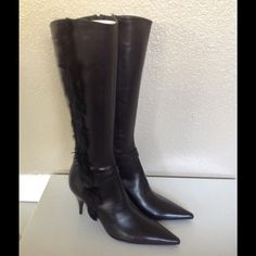 """Black Leather Pointy Fur Detail Knee High Boots """"This gorgeous Italian-made dress boot combines sleek styling with just enough detail to capture attention. Soft premium leather uppers shape a knee-high boot with a pointed toe, button detail, and fur trim. A 3 inch tapered heel completes the feminine silhouette. """" Charles david. Size 7 Color Black Charles David Shoes Heeled Boots"""