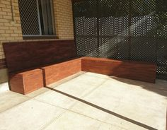 Another view of the sitting area outside. L shaped decked seating area. Stained Malibu brown.