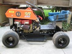 How to Make a Racing Lawn Mower (Updated!) How to Make a Racing Lawn Mower (Updated! Martini Racing, Fox Racing, Kart Racing, Go Kart Plans, Lawn Mower Repair, Riding Mower, Bike Shed, Karting, Amazing Gardens
