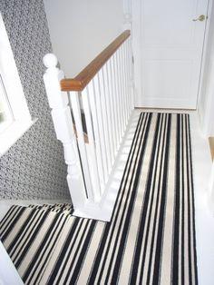 black and white striped carpet runner on landing
