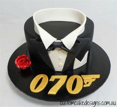 007 70th Birthday Cake by Custom Cake Designs