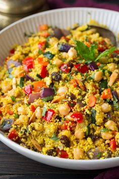 Moroccan+Couscous+with+Roasted+Vegetables+Chick+Peas+and+Almonds. Delicious, nutritious, and beautiful. Would keep for a while in the fridge. Made with whole wheat couscous. Roasted Vegetable Couscous, Couscous Salad Recipes, Chickpea Recipes, Almond Recipes, Roasted Vegetables, Vegetarian Recipes, Cooking Recipes, Healthy Recipes, Roast Vegetable Salad
