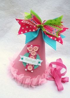 Cute as a Button Birthday Party Hat in Pink, Aqua & Lime Polka Dot. $15.50, via Etsy.