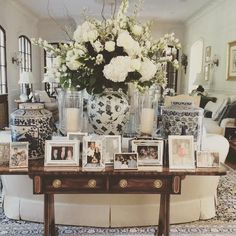 side table / styling / vignette / glam / picture display / white flower boquet