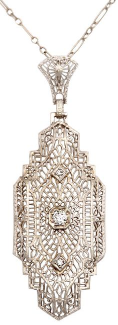 Art Deco 'lighter than air' diamond pendant, circa 1920's-1930's. White gold and platinum filigree and diamonds. Via Diamonds in the Library.