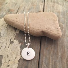 Hand stamped initial necklace. This sterling piece is simple and sweet.