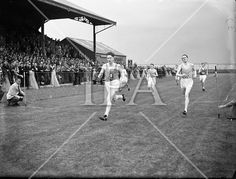 Cavanagh, T. Carrigfoyle, Fermoy (left) winning the 440 yard flat at Iveagh Grounds, Crumlin from D MacCarville See more photos like this at www. History Photos, Photo Archive, More Photos, Ireland, Dolores Park, Yard, Fine Art, Flat, Gallery