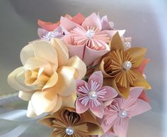 You will receive one paper flower bouquet in your choice of colors and middle findings. (Rhinestones, pearls, buttons, ect).  This bouquet is