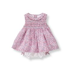 Our cotton set with dainty florals is sweet for every occasion. Features smocking, ruffle collar and bow accents.