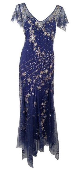 A current celestial inspired midnight blue gown from the 2016 Belville-Sassoon collection with silver stars embellishements over a light and airy tulle.