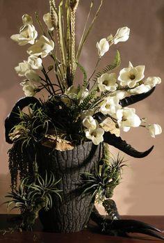 Magnolias, Succulents and Horns arrangement in Bark like Planter