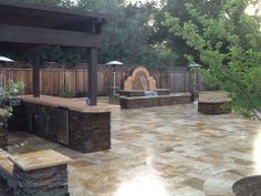 Not only does the natural stone look GORGEOUS! Look at the design of the outdoor kitchen and the fountain!