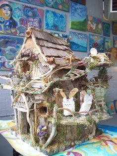 *the little fairy's house in the woods*.........by *sunflowerhouse* on etsy......you REEEEEEEALLY NEED to click through to SEE more photos and read about these WILDLY creative fairy houses made of all natural materials!!!! oh........and to see the prices!!!!! LOL!!! :-)