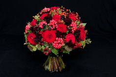 These gorgeous hand-tied bouquets are the creation of talented florist Ivvo Markou whose contemporary style is a blend of elegance and simple design ingenuity. The high end luxury bouquets feature top quality Red Naomi roses from Porta Nova.