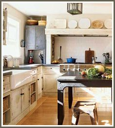 Modern/rustic. Note shelves with baskets. Cheaper than drawer option. Also handy to grab basket and set on counter or table for easy use.