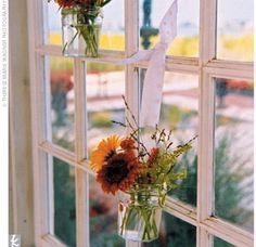 The doors to the boathouse were open so a beautiful breeze flowed; a small votive filled with flowers and greenery was hung by ribbon on each window.