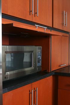 No, we do not have to hide the microwave. Nice cabinets, though.