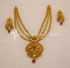 Designs that take your breath away! Gorgeous Antique Necklace set embellished with Kundans and pretty leafy gold strings and a unique antique finish to make this exquisite set. Gold Earrings Designs, Gold Jewellery Design, Gold Jewelry, Beaded Jewelry, Designer Jewellery, Stone Jewelry, Diy Jewelry, Antique Necklace, Antique Jewellery