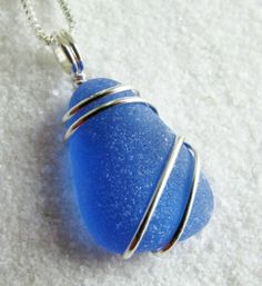 Blue sea glass pendant. #sea glass beads & #sea charms: http://www.ecrafty.com/c-780-sea-glass-beads.aspx?pagenum=1===newarrivals=60