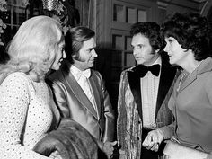Husband and wife teams take a breather as Tammy Wynette, left, and George Jones chat with Merle Haggard and Bonnie Owens during the BMI Awards banquet at the Belle Meade Country Club Oct. 16, 1973.