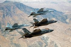 FALLON Nev. (Sept. 3 2015) F-35C Lightning IIs attached to the Grim Reapers of Strike Fighter Squadron (VFA) 101 and an F/A-18E/F Super Hornets attached to the Naval Aviation Warfighter Development Center (NAWDC) fly over Naval Air Station Fallons (NASF) Range Training Complex. VFA 101 based out of Eglin Air Force Base is conducting an F-35C cross-country visit to NASF. The purpose is to begin integration of F-35C with the Fallon Range Training Complex and work with NAWDC to refine tactics…