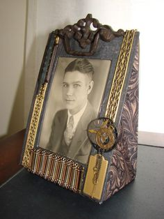Picture frame made from a tissue box, a plastic egg carton, and scrapbooking supplies