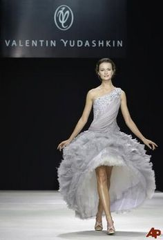 Designer: Valentin Yudashkin. The Russian bridal dress is uniquely open toward the front. The ruffles at the bottom compliment the crystal one-shouldered top gracefully.