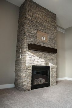 Gas Fireplace With Elegant Floor To Ceiling Eldorado   Nantucket Stone.  Floating Shelf Is Poplar