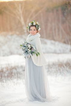 Light blue wedding dress + Muted grays and blues bridal portrait in the snow | fabmood.com #winter #weddingportraits #fineartwedding