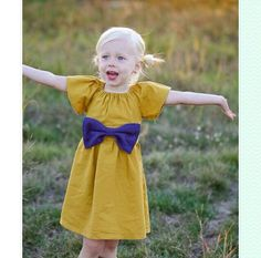 Mustard yellow peasant dress with navy bow by LoveyLake on Etsy